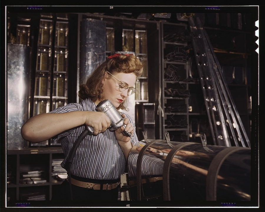 Palmer, Alfred T.,, photographer.</p><br /><br /><br /> <p>Operating a hand drill at North American Aviation, Inc., [a] woman is working in the control surface department assembling a section of the leading edge for the horizontal stabilizer of a plane, Inglewood, Calif....