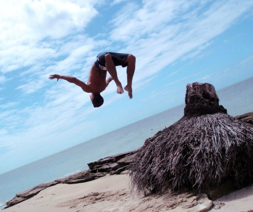 Beach of maria flour. Paulista. Janga. Pernambuco.<br /><br /><br /><br /> Artur jumping.